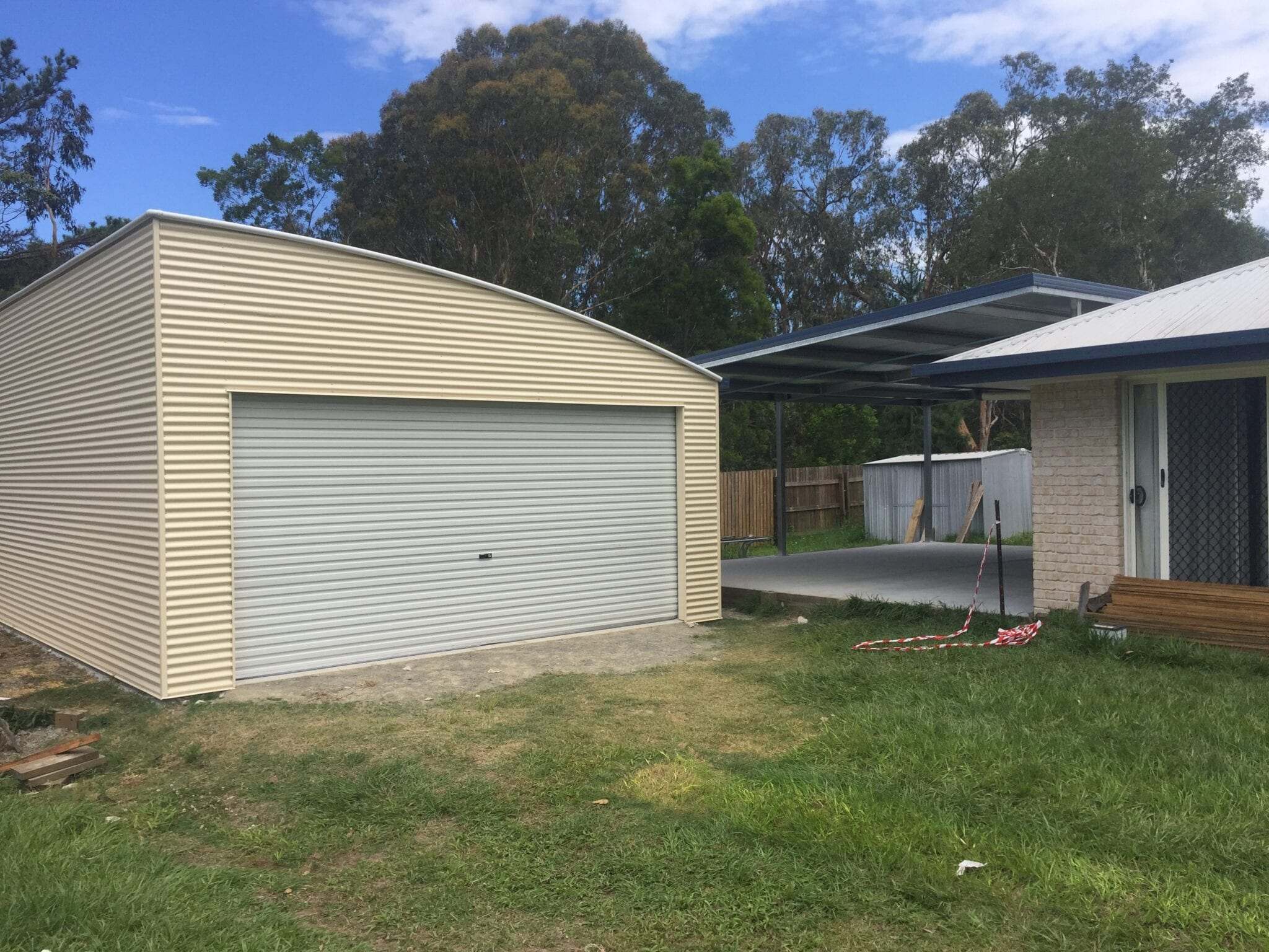 Curved Roof Cream garage and owning