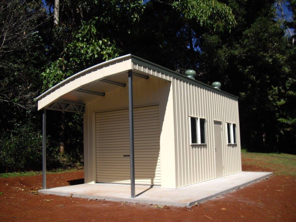 Curved cream shed with wirlibirds