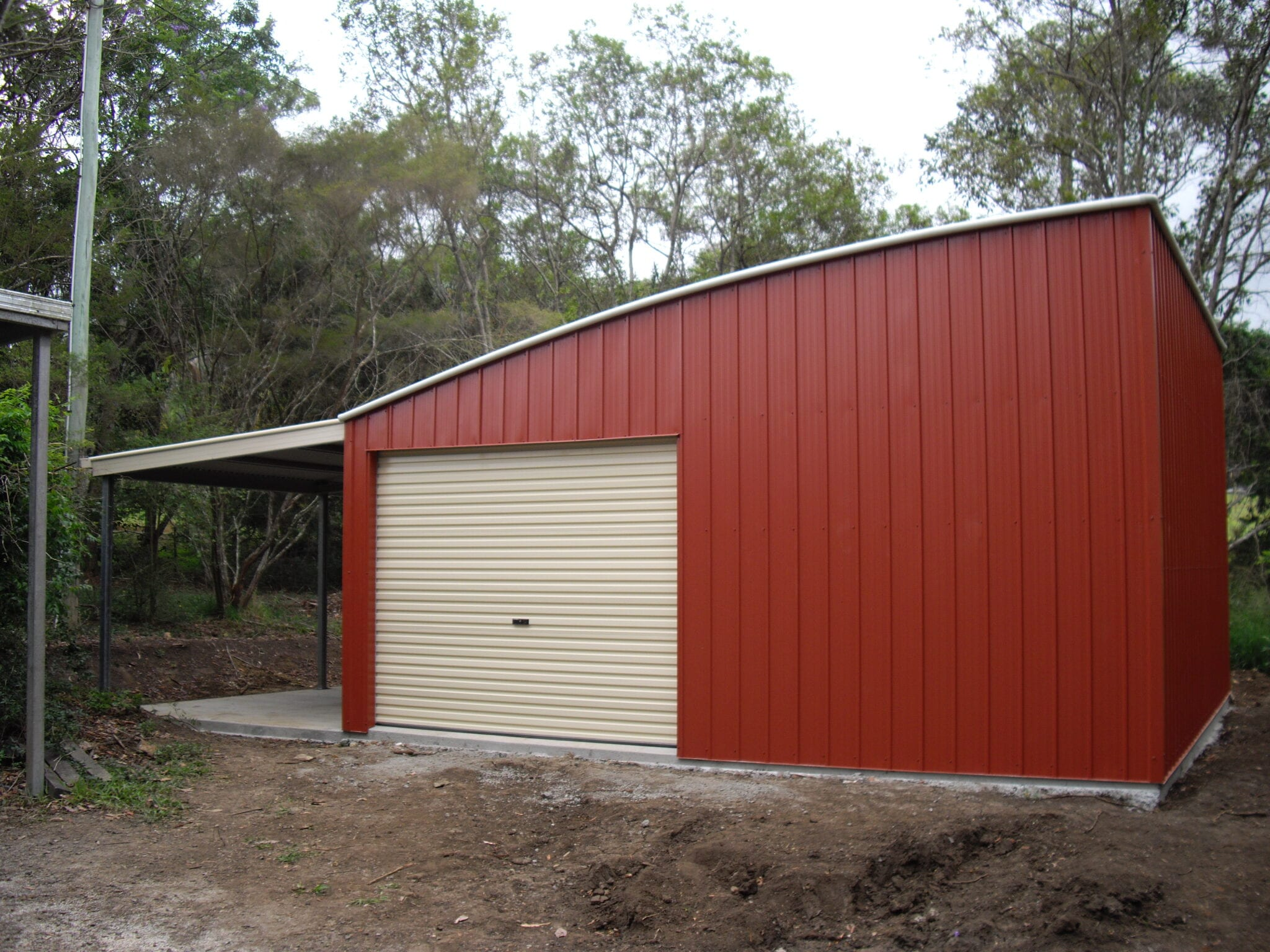 Curved red shed with owning