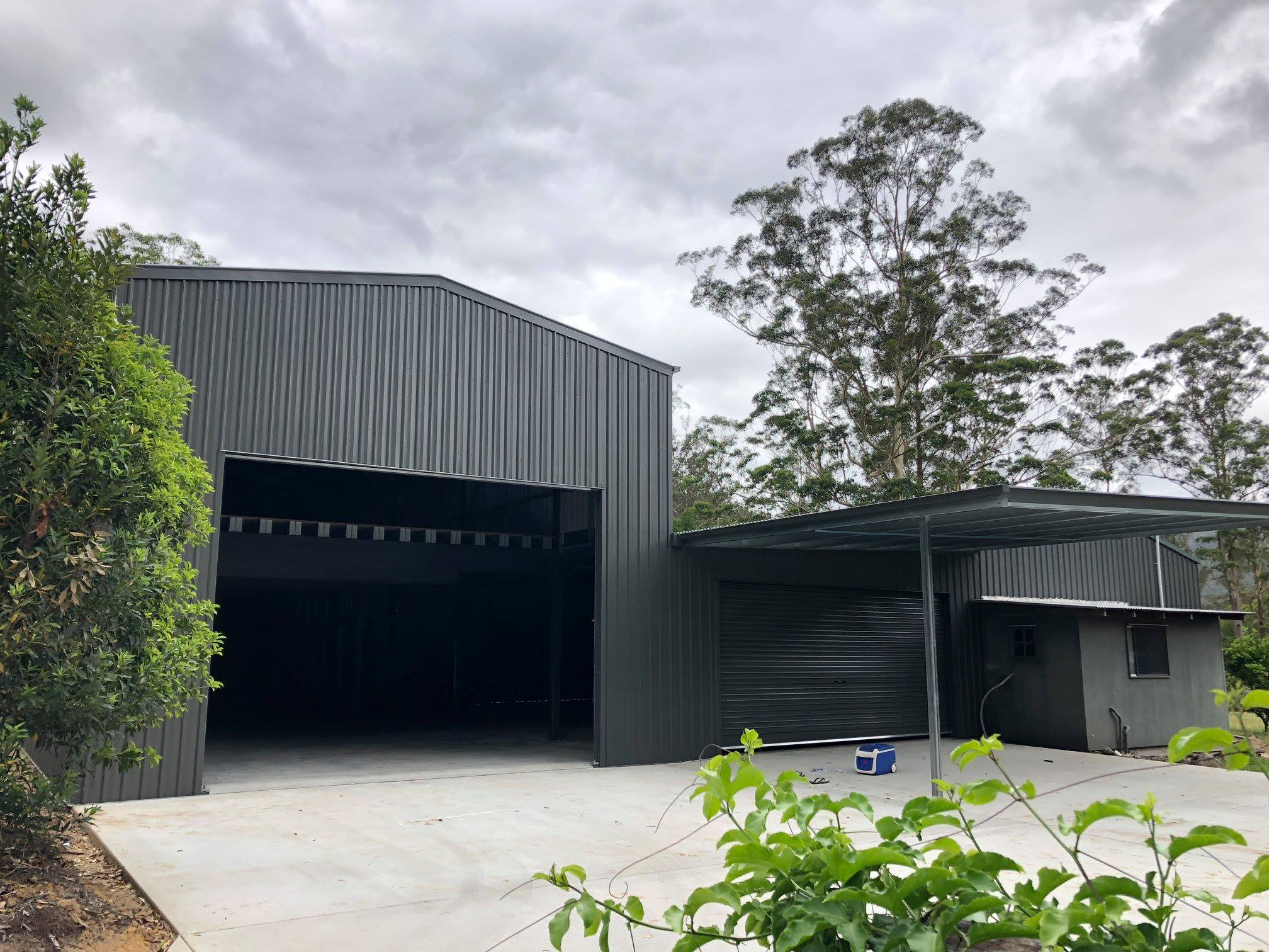 Gable black shed garage with owning added