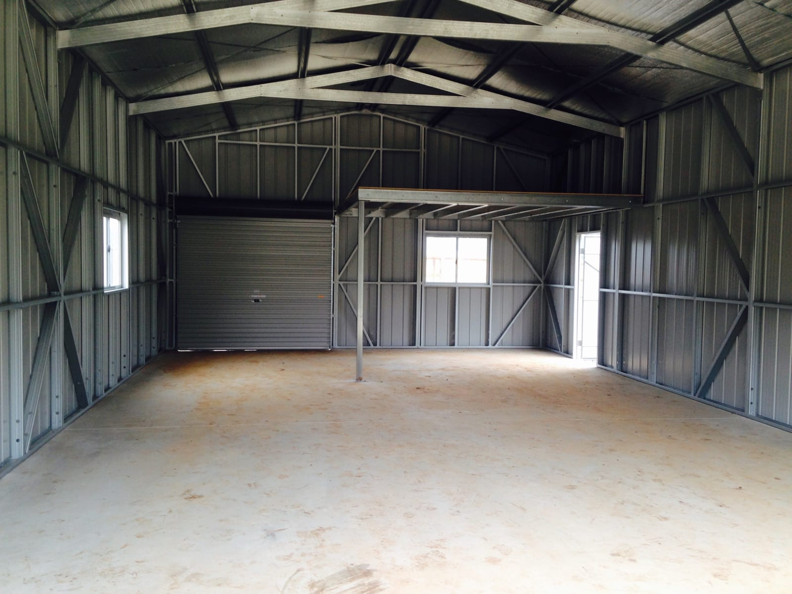 Inside gable shed with lift
