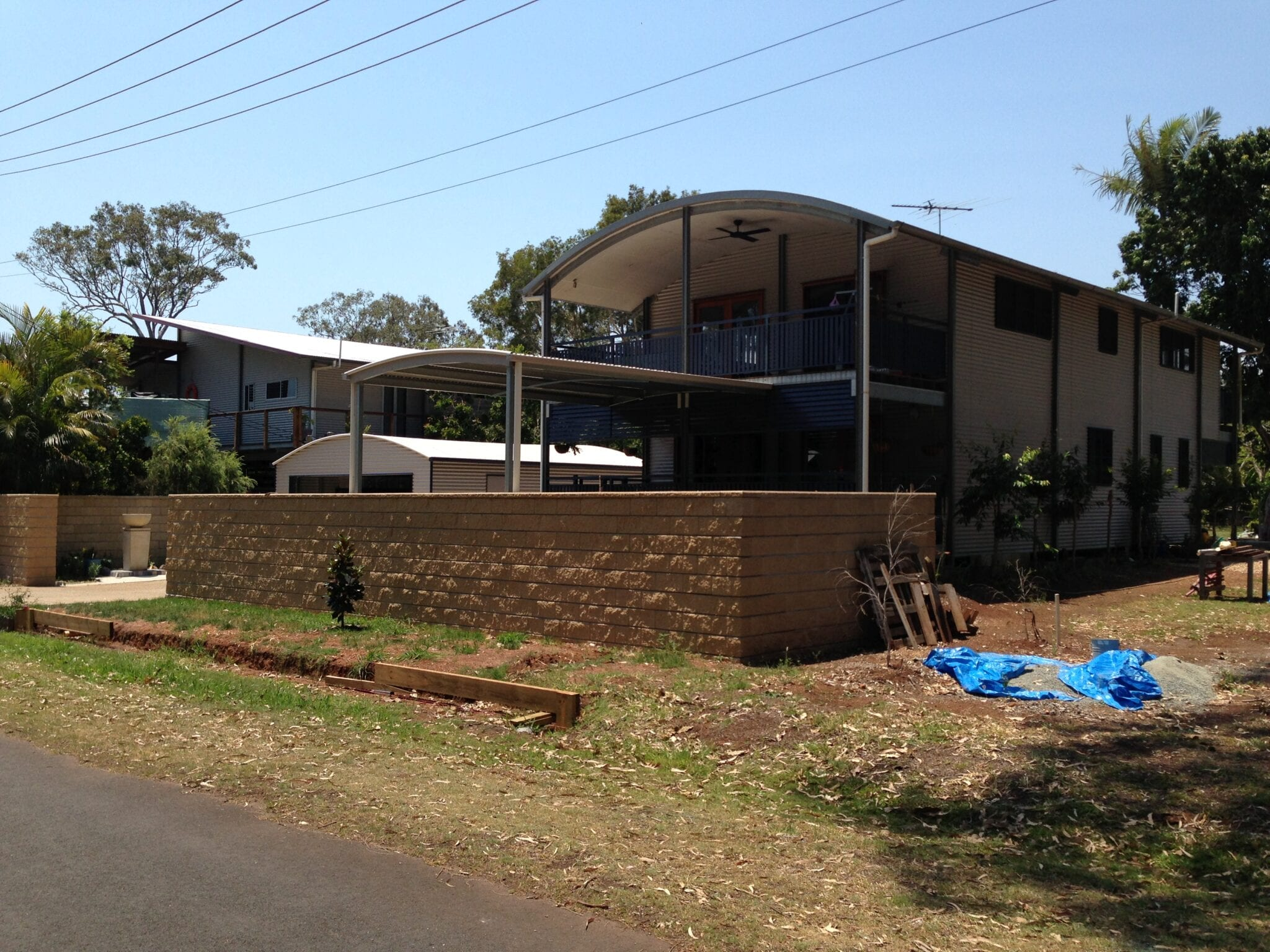 Two story curved roof liveable with carport