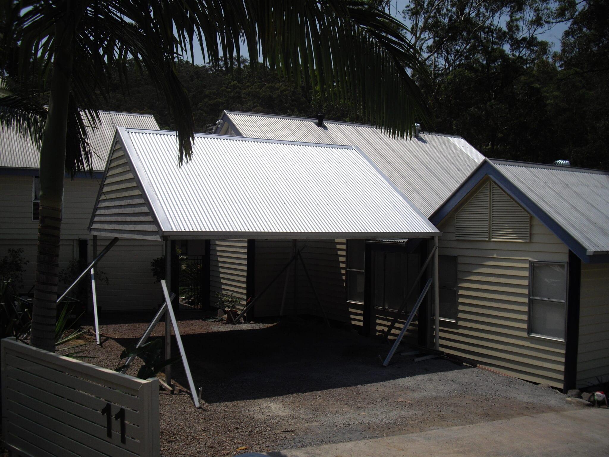 White gable single carport