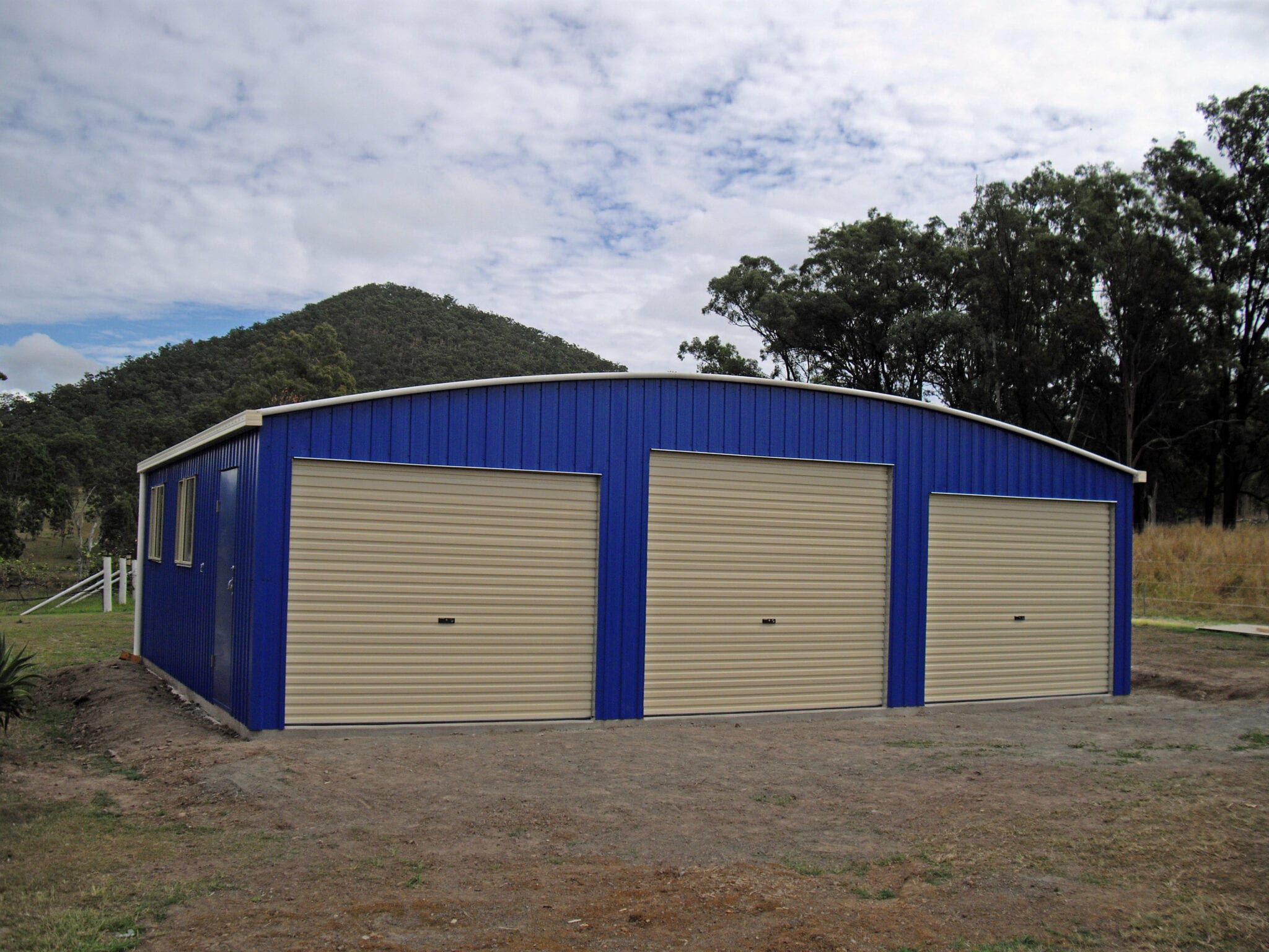Curved blue shed 3x rollerdoors
