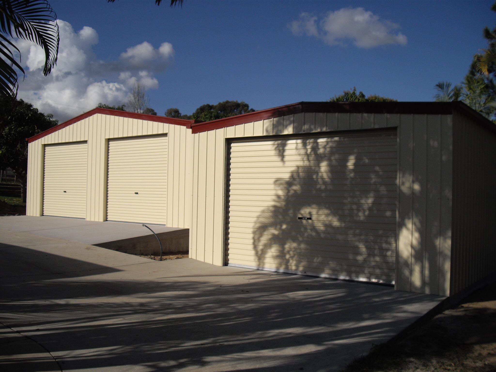 Double gable cream garages red roofing
